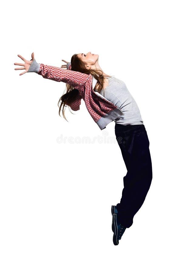 Verticale de jeune fille branchante dans l'entre le ciel et la terre image stock