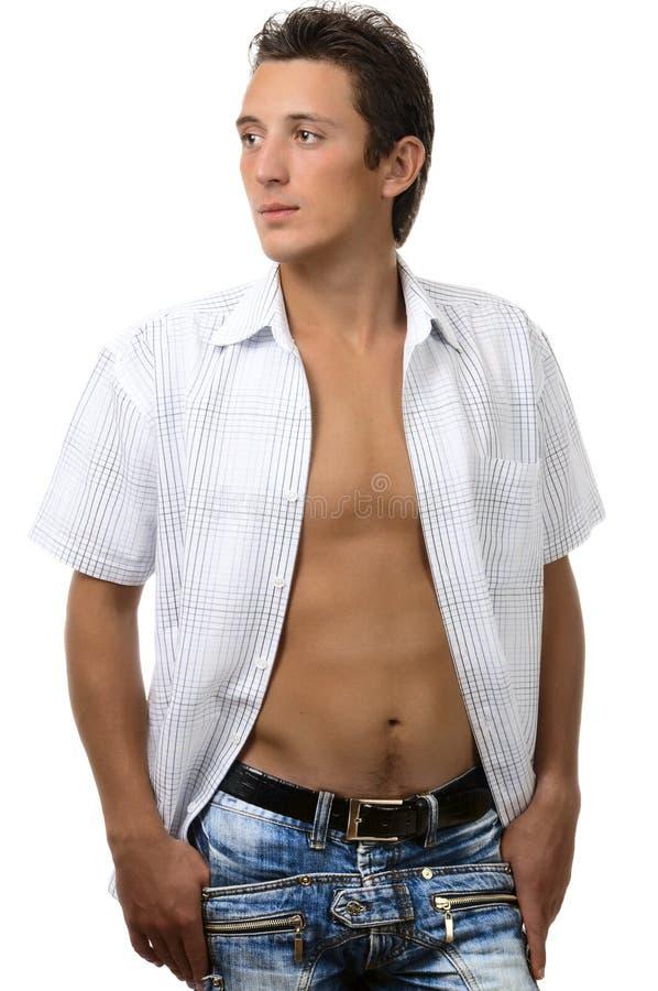 Verticale de jeune homme sexy dans des jeans images stock