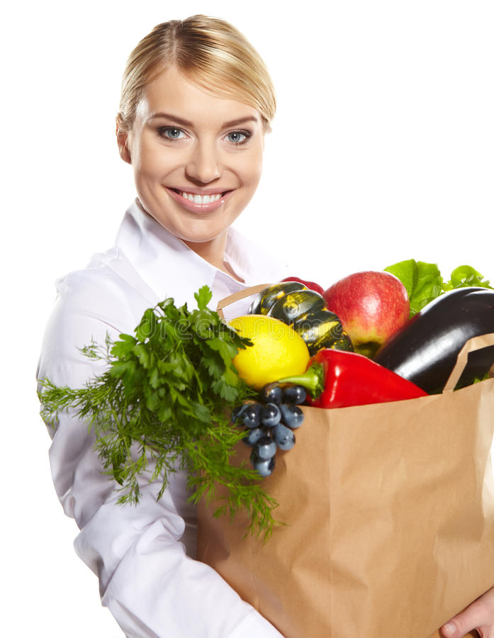 Verticale de la femme heureuse d'affaires retenant un sac à provisions photos stock