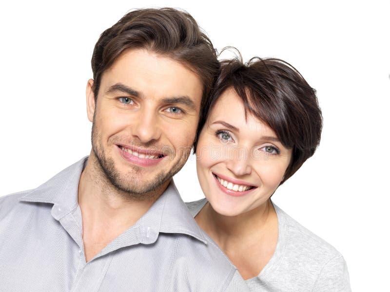 Verticale de plan rapproché de beaux couples heureux - d'isolement image stock