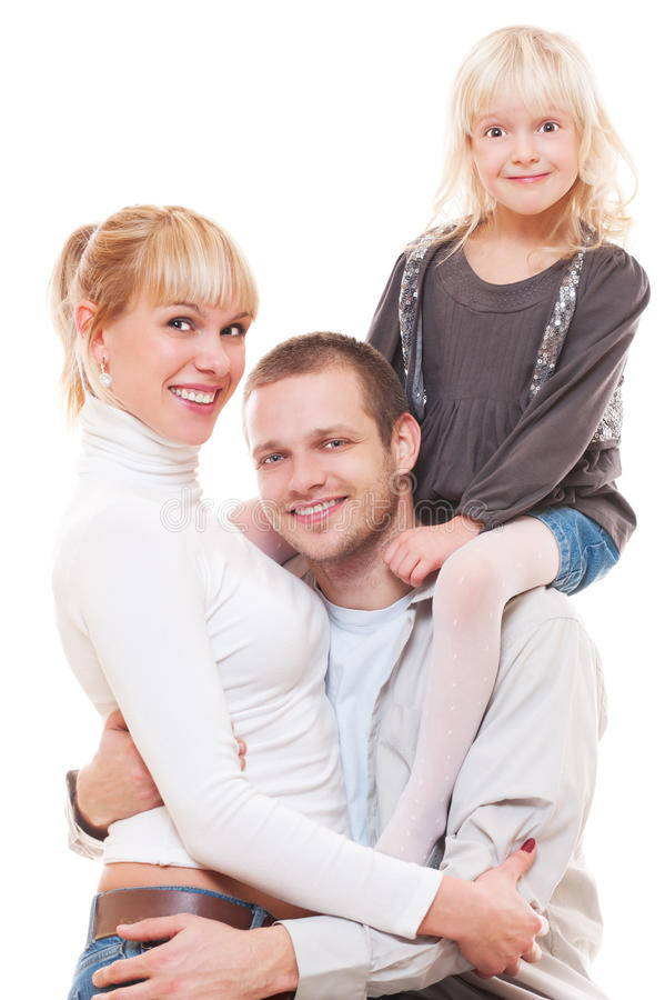 Verticale de studio de jeune famille photo stock