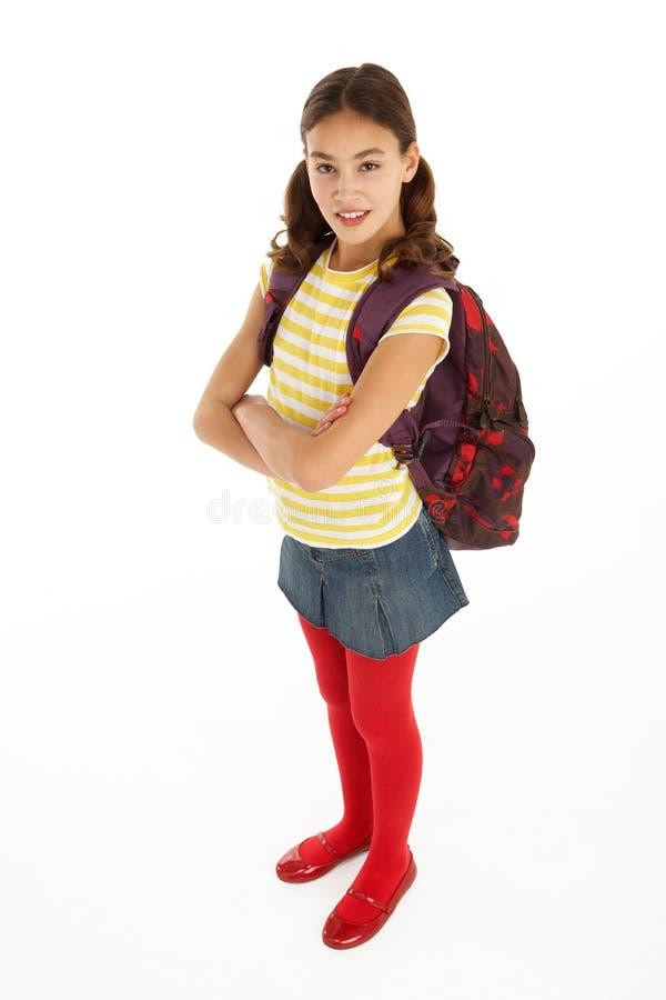 Verticale de studio de jeune fille avec le sac à dos photo stock