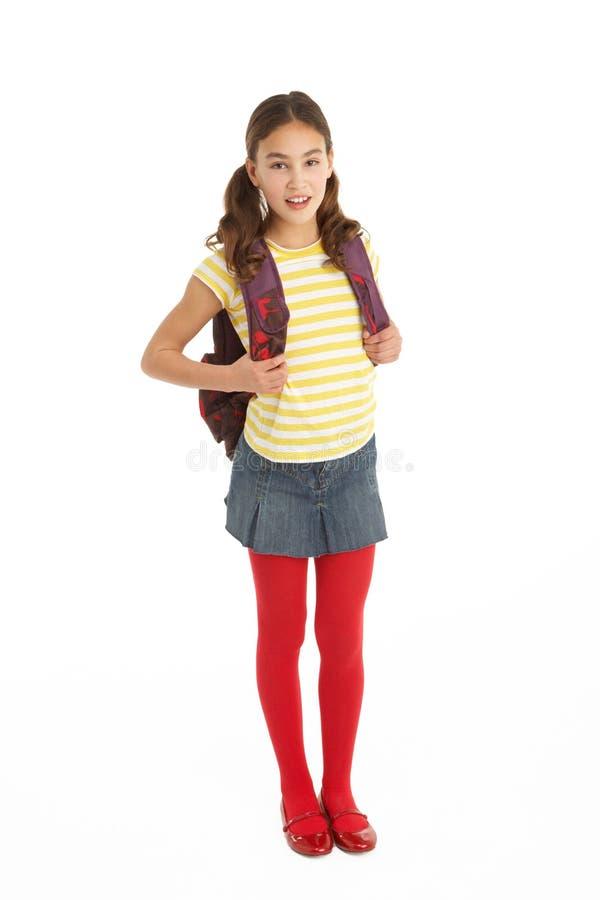Verticale de studio de jeune fille avec le sac à dos photos stock