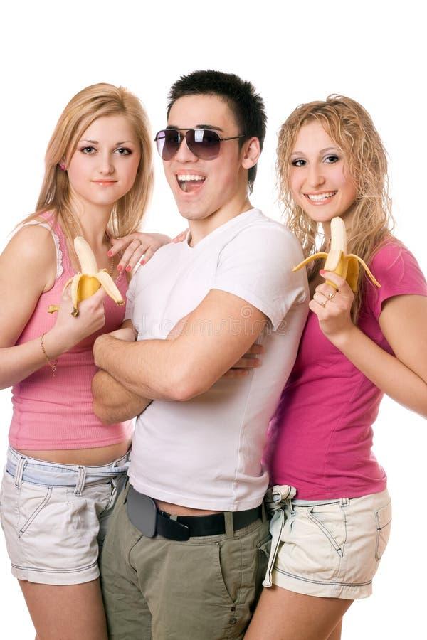 Verticale des trois jeunes joyeux photos libres de droits