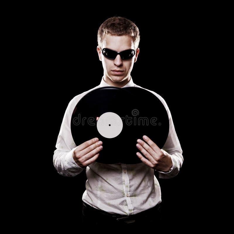 Verticale du DJ beau avec des vinyles image stock
