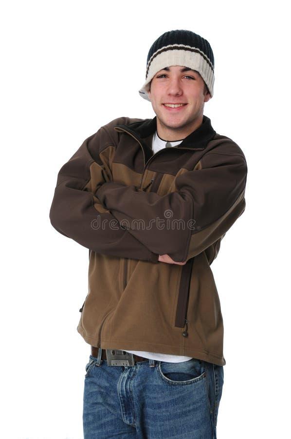 Verticale du sourire de l'adolescence de garçon image libre de droits