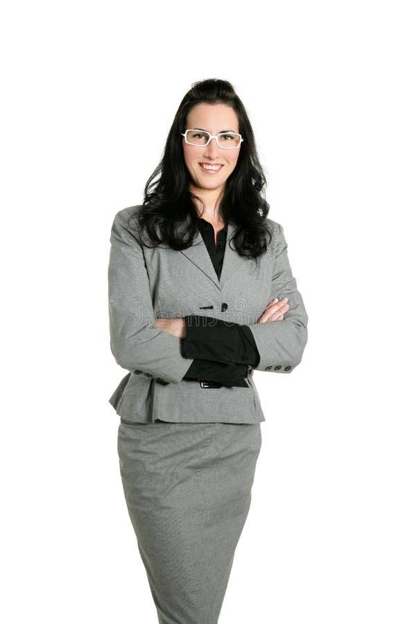 Verticale grise de procès de brunette de femme d'affaires photographie stock libre de droits