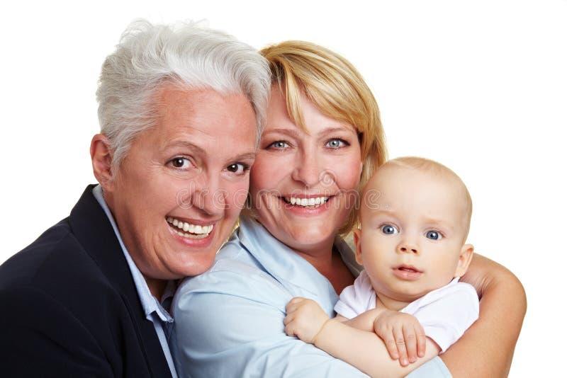 Verticale heureuse de famille avec la chéri image stock