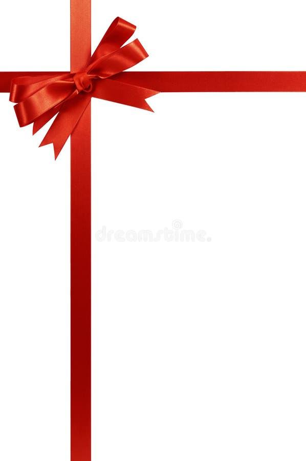 Verticale rouge de ruban de cadeau de Noël d'arc photos stock