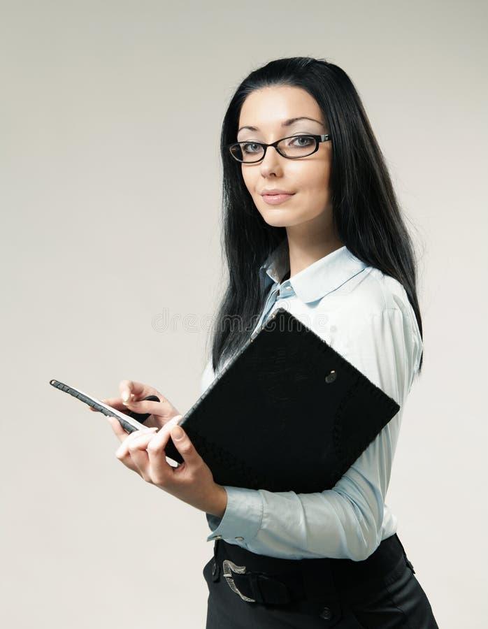 Verticale sexy de femme d'affaires de brunette photo libre de droits