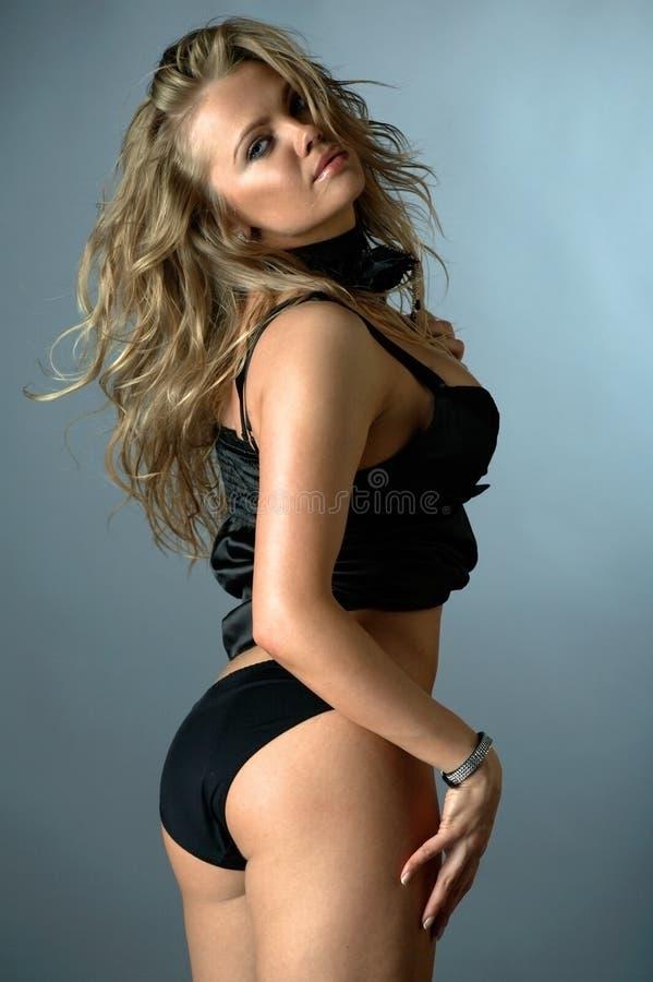 Verticale sexy de femme de charme photographie stock libre de droits