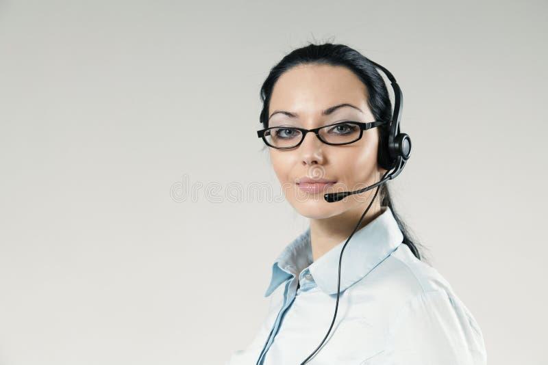 Verticale sexy de plein visage d'opérateur de centre d'attention téléphonique image libre de droits