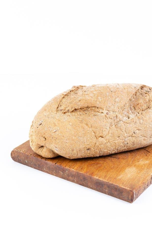 Vertikal bild med Chrono bröd med sädesslag royaltyfria foton