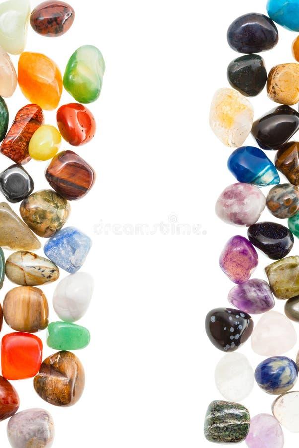 Vertikal ram från naturliga mineraliska gemstones royaltyfria bilder