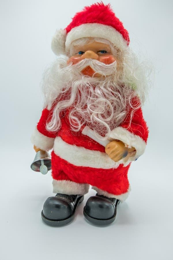 Vertikal sikt av det Santa Claus leksakdiagramet på vit bakgrund royaltyfria bilder