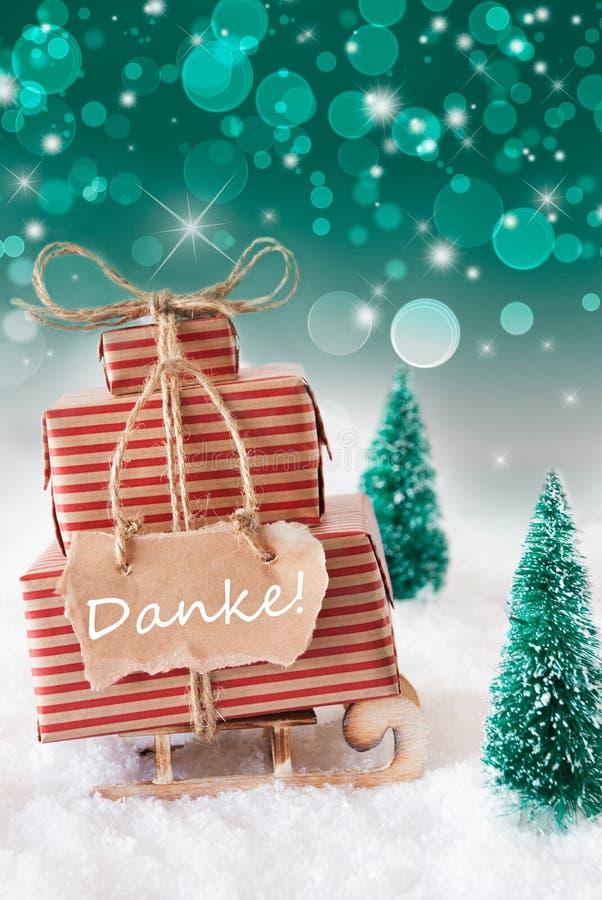 Vertikaler Weihnachtspferdeschlitten auf grünem Hintergrund, Danke-Durchschnitte danken Ihnen stockfotos