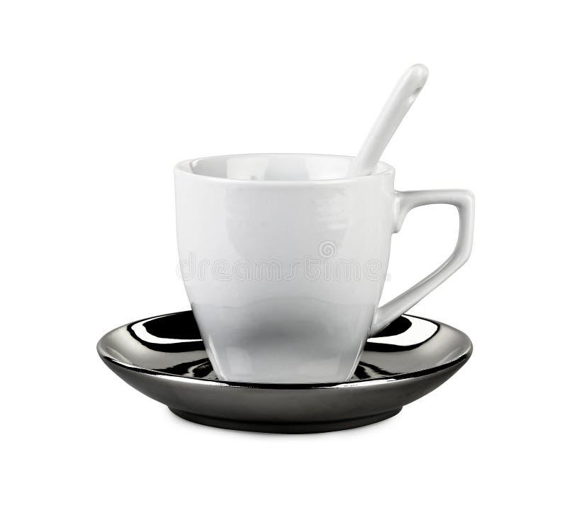 Vervollkommnen Sie weißen Kaffee oder Teeschale mit Löffel stockbilder