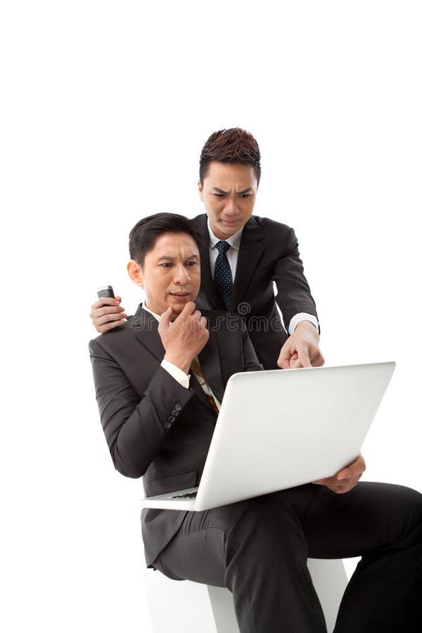 Verwarde Aziatische managers royalty-vrije stock afbeelding