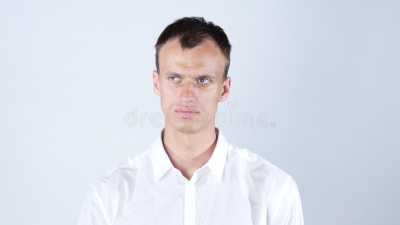 Verwarde en verstoorde zakenman met droevige uitdrukking stock foto