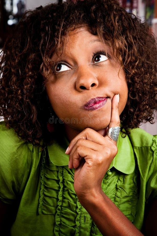 Download Verwarde jonge vrouw stock afbeelding. Afbeelding bestaande uit zwart - 10779427