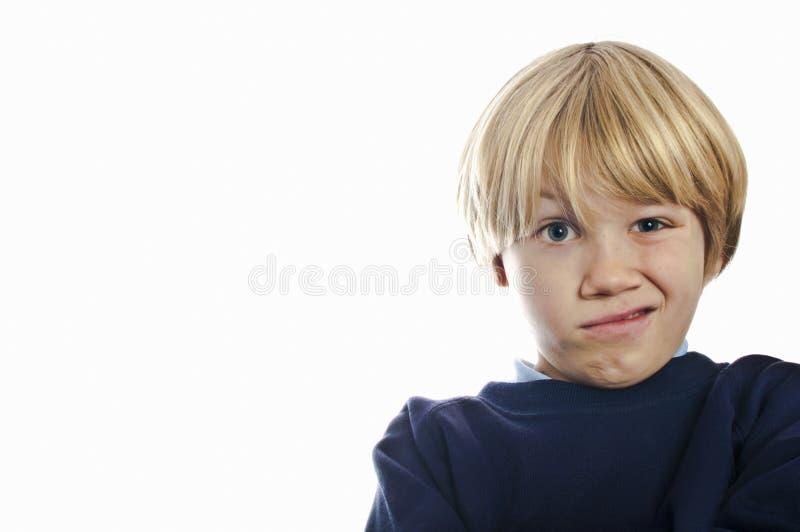 Verwarde schooljongen stock fotografie