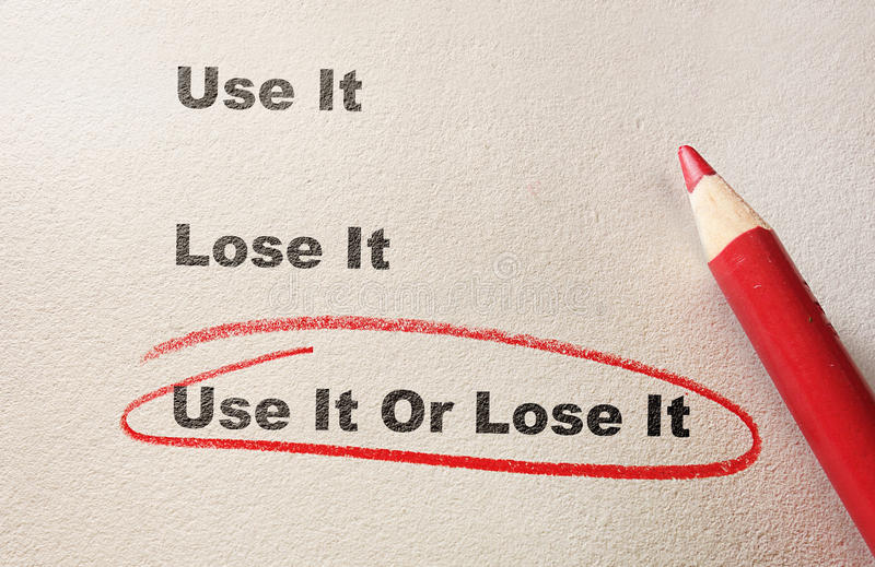 Verwenden Sie es oder verlieren Sie es Mitteilung lizenzfreies stockfoto