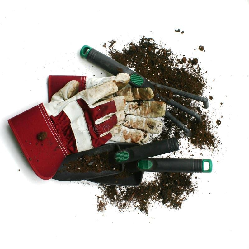 Verwendete Gartenarbeit/Arbeitshandschuhe und -hilfsmittel lizenzfreie stockfotos