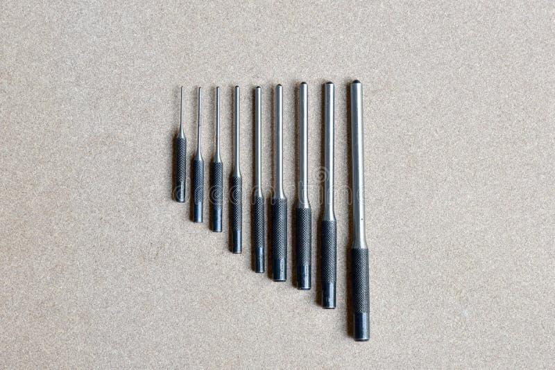Verwijderen de de stempel vastgestelde hulpmiddelen van de broodjesspeld voor speld of klink van om het even welke werktuigkundig stock afbeeldingen
