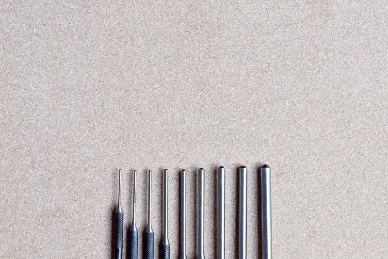 Verwijderen de de stempel vastgestelde hulpmiddelen van de broodjesspeld voor speld of klink van om het even welke werktuigkundig stock foto