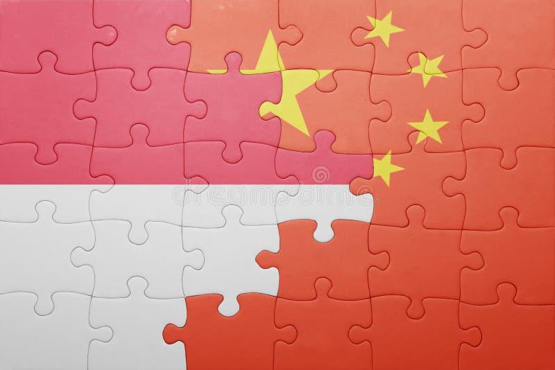 Verwirren Sie mit der Staatsflagge des Porzellans und des Indonesiens stockbilder
