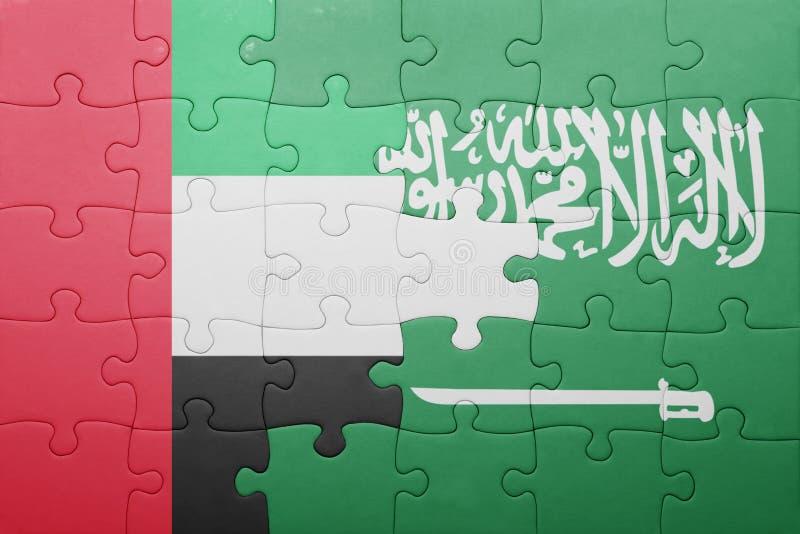 Verwirren Sie mit der Staatsflagge von Saudi-Arabien und von Vereinigten Arabischen Emiraten lizenzfreie stockbilder