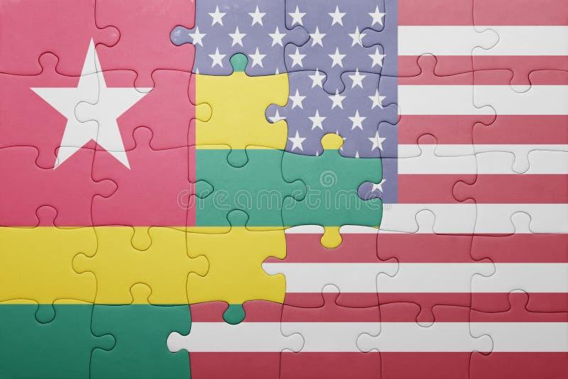 verwirren Sie mit der Staatsflagge von Staaten von Amerika und von Togo lizenzfreie abbildung