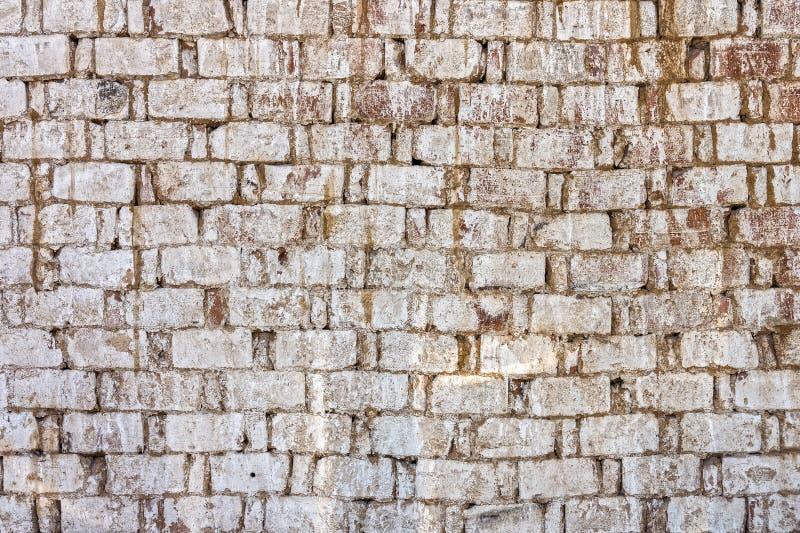 Verwitterte alte Ziegelsteinwand stockfotos