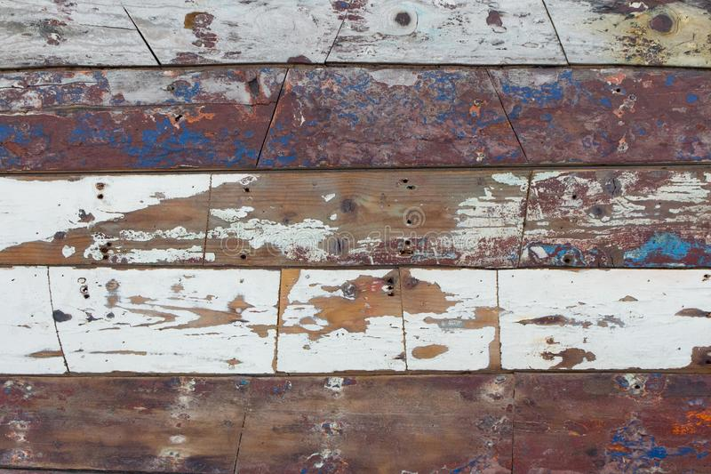 Verwitterte Wand der hölzernen Bretter Gemaltes Hartholz Raue hölzerne Planken Kreatives decotarion lizenzfreies stockfoto