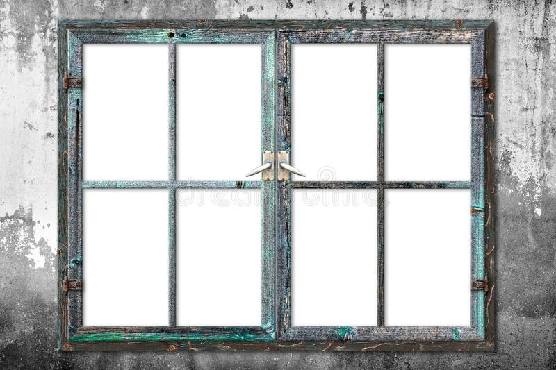 Very aged wooden window frame with cracked paint on it, mounted on a grunge wall. The glass section is isolated on white background, so you can put your stock photography