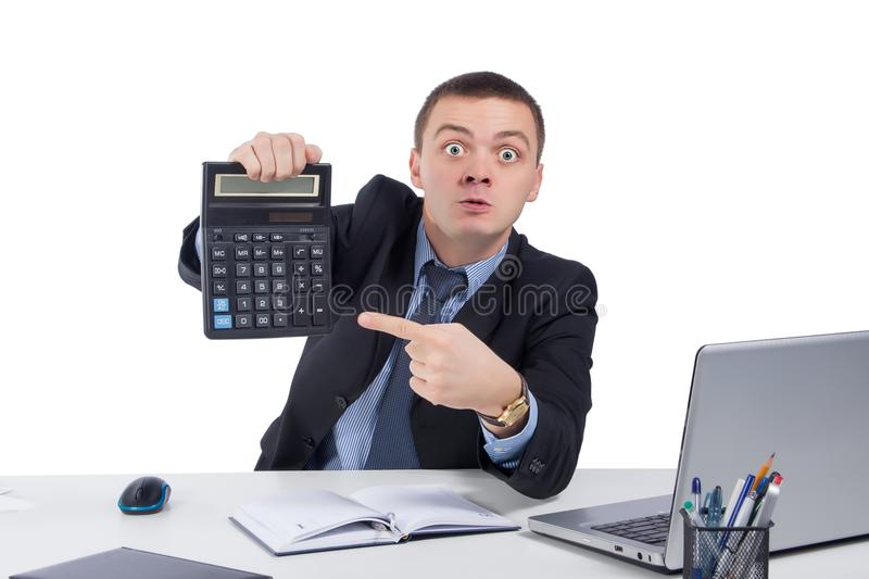 Very angry businessman in office, holding a calculator stock photo