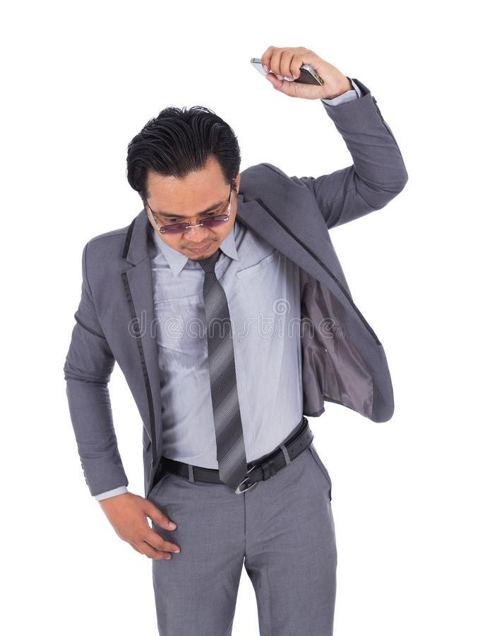 Very angry businessman is throwing away his mobile phone isolate stock images