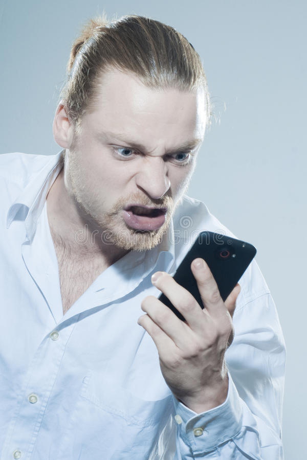 Download Very angry man on telepone stock photo. Image of communication - 39500960
