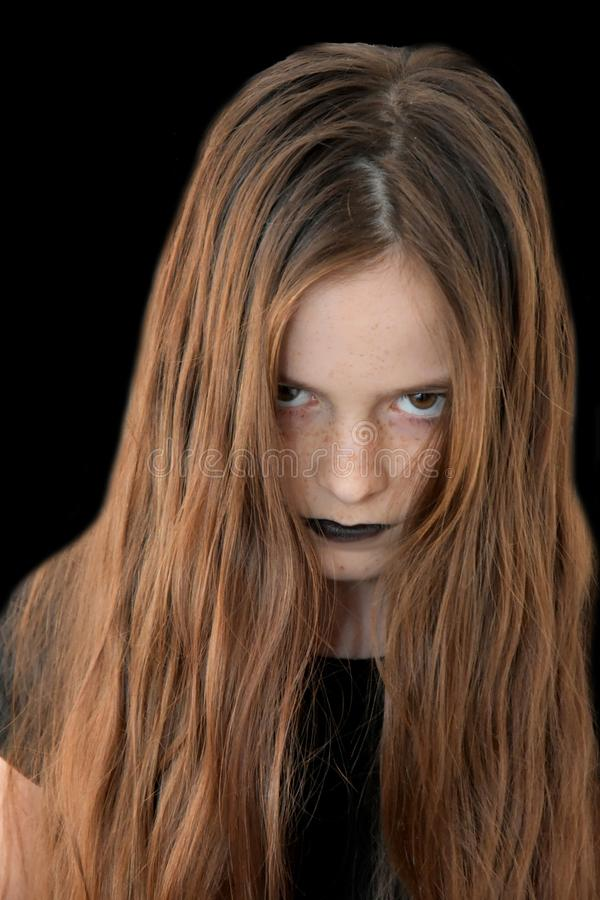Very angry looking teenage girl stock image