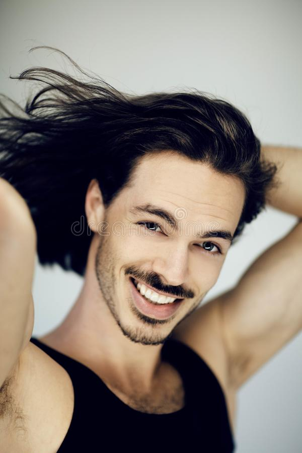 Very attractive young, athletic, muscular man smiling beauty portrait royalty free stock photography