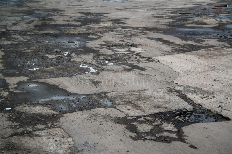 Very bad quality road. With potholes in Ukraine stock photo