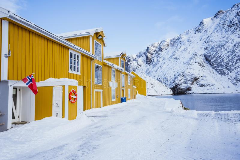 Very beautiful bay in the sea with a big yellow houses on the coast, winter time royalty free stock image