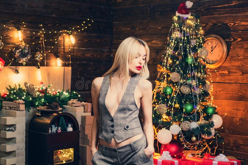 Very beautiful blonde girl over Christmas tree. Merry Christmas and happy new year. Sensual Christmas girl. Beautiful. Girl portrait royalty free stock photos