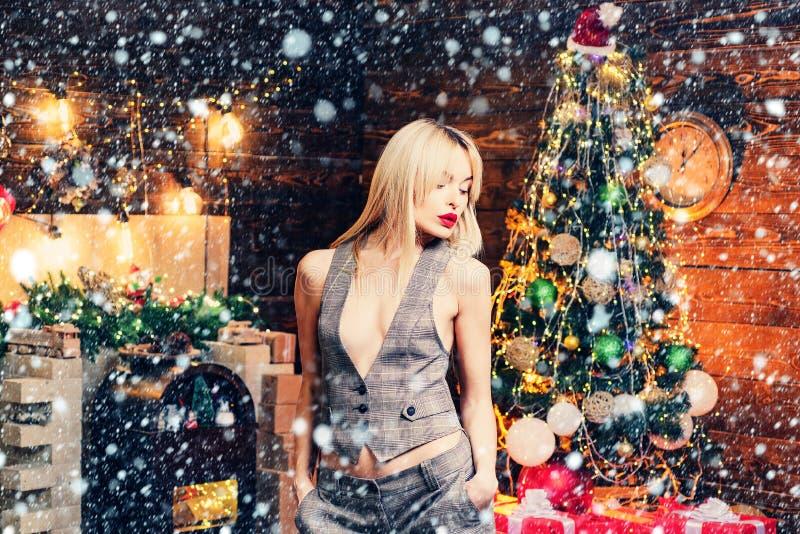 Very beautiful blonde girl over Christmas tree. Merry Christmas and happy new year. Sensual Christmas girl. Beautiful stock image