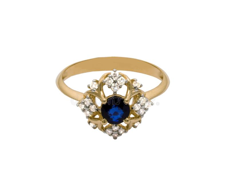 Very beautiful golden ring with big sapphire and diamonds royalty free stock photo