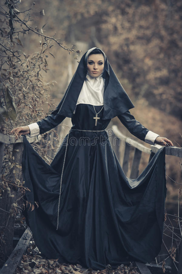 The very beautiful, seductive, attractive, sexual, awesome, gorgeous nun. Powerful nun pray for life. royalty free stock photos