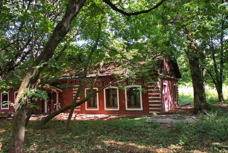 Very beautiful red brick house surrounded by trees and grass royalty free stock image