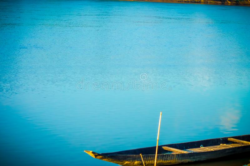 Very beautiful scenery of river water with sail boat royalty free stock photography