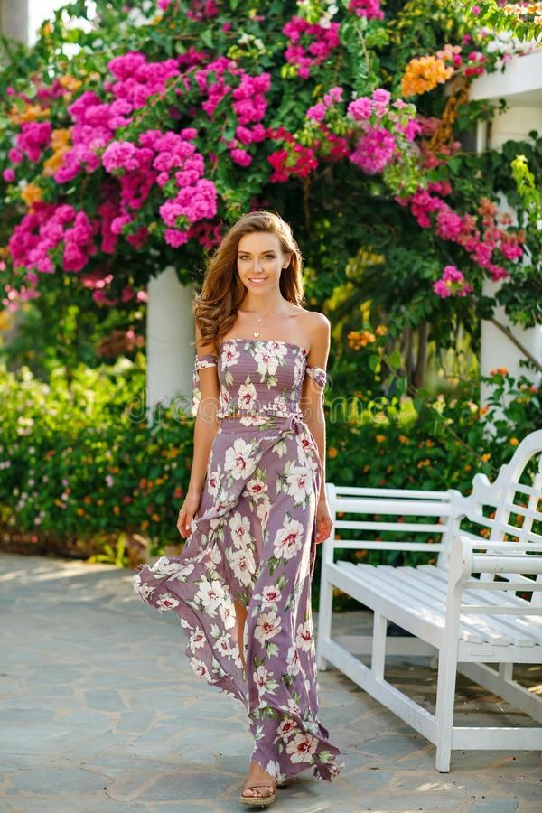 A very beautiful sensual and girl in a long dress is walkin stock image
