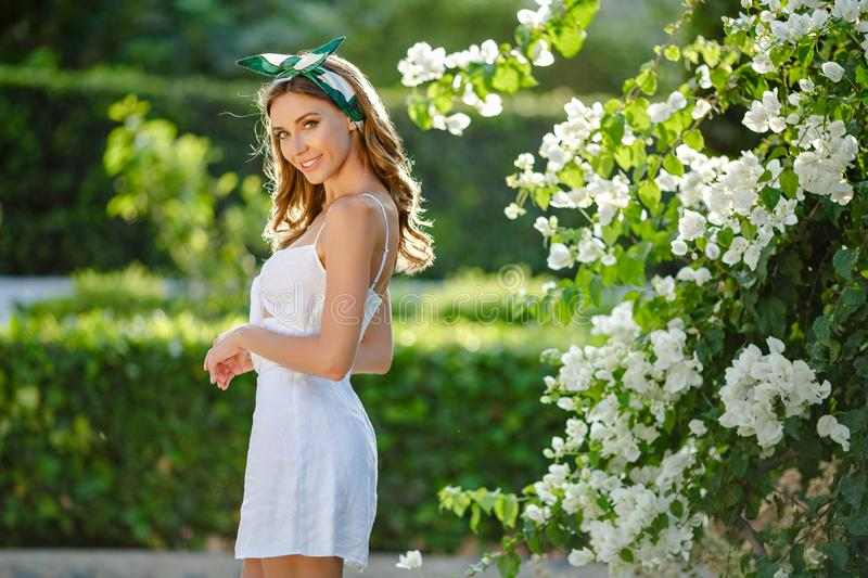 Very beautiful sensual and girl in a white dress and solohe stock photos